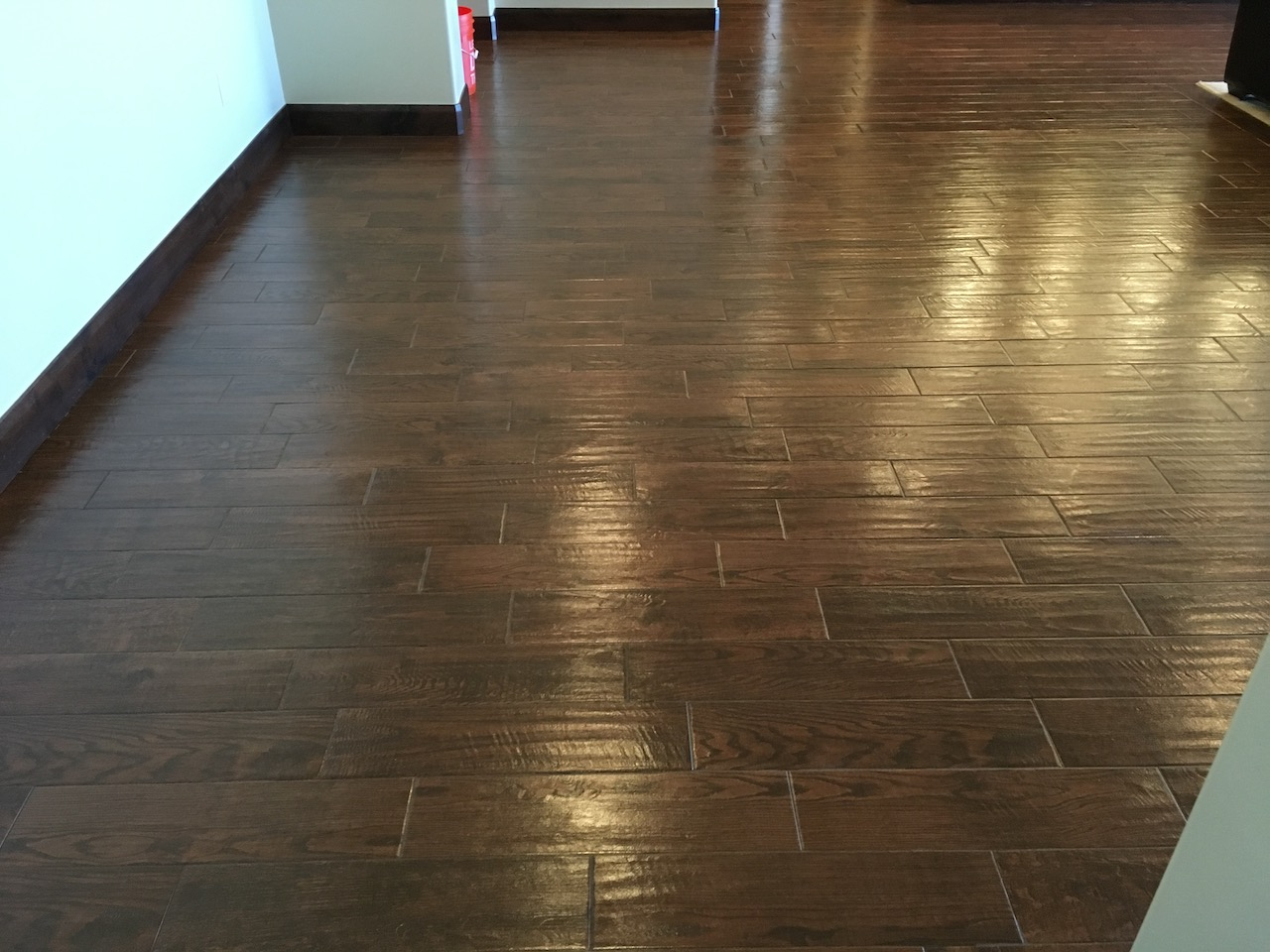 "Topical sealer applied to ""wood like"" plank porcelain"
