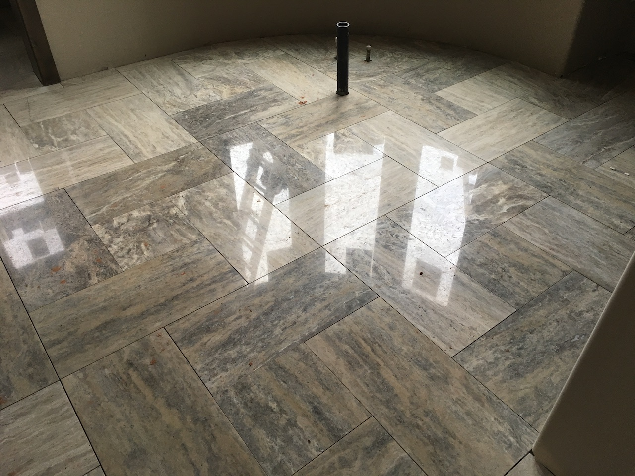 Polished vein cut travertine as installed in this before picture