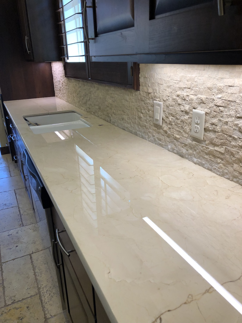 TuffSkin enhances the look of the stone and protects the surface from etching and staining.