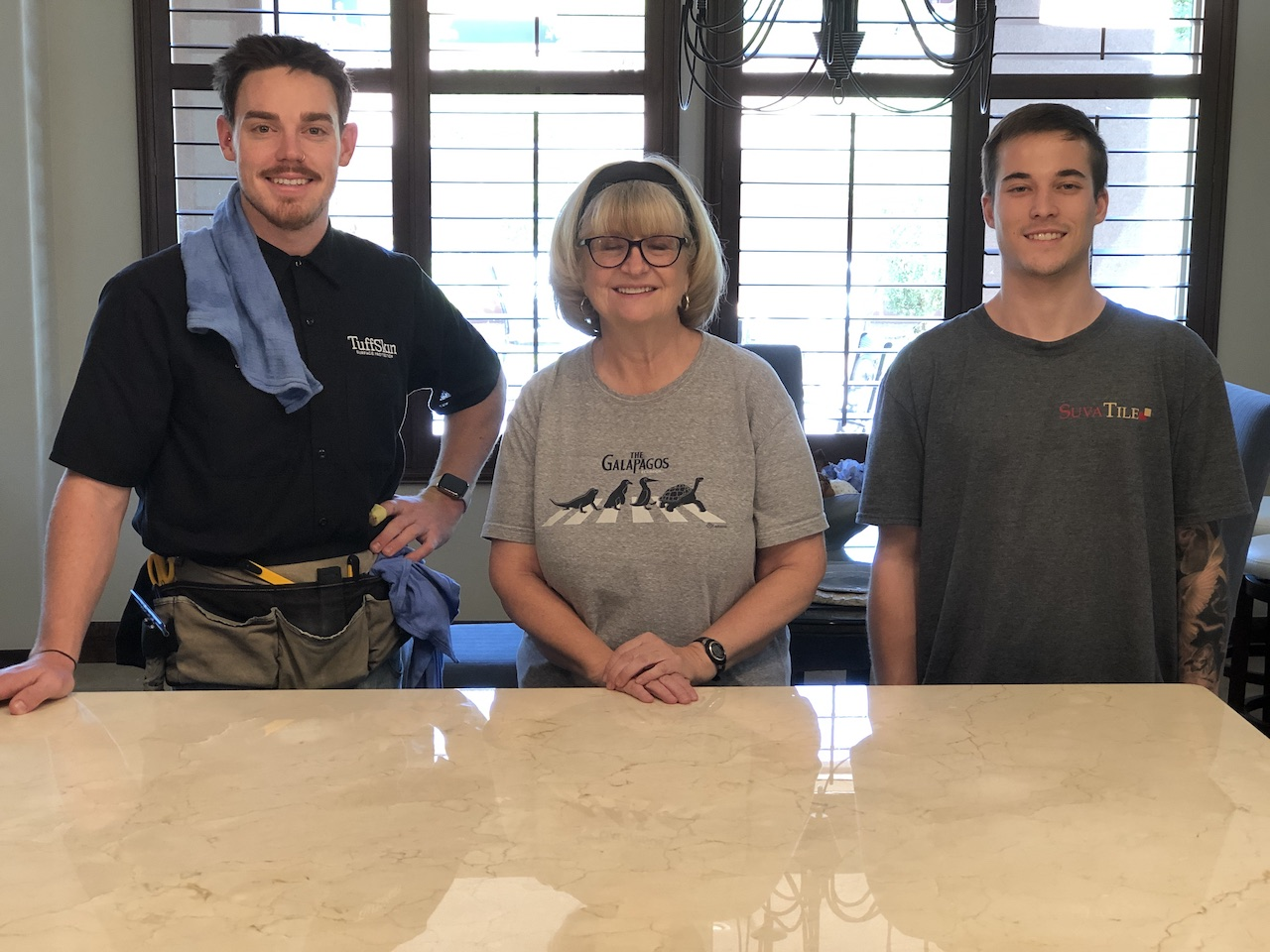 Everyone is Happy! Jake with TuffSkin, Lois the homeowner and Skylar with Suva Tile.