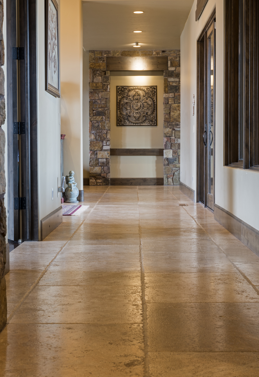 The large stone tiles accent the length of this hallway