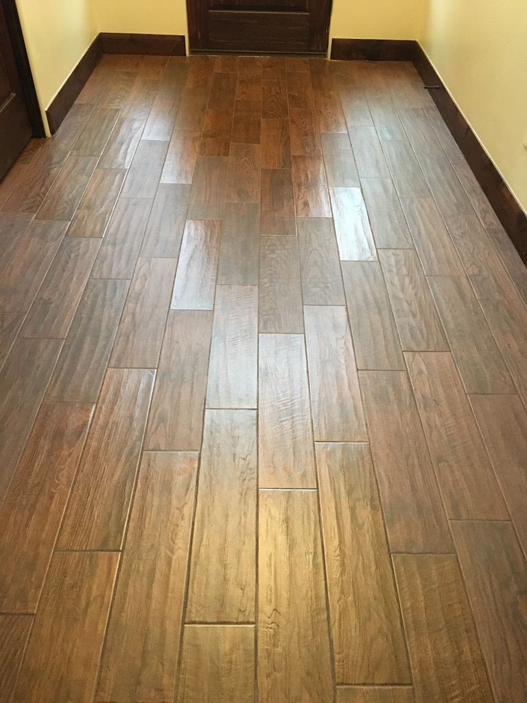 The inconsistent sheen of the planks shows in this picture