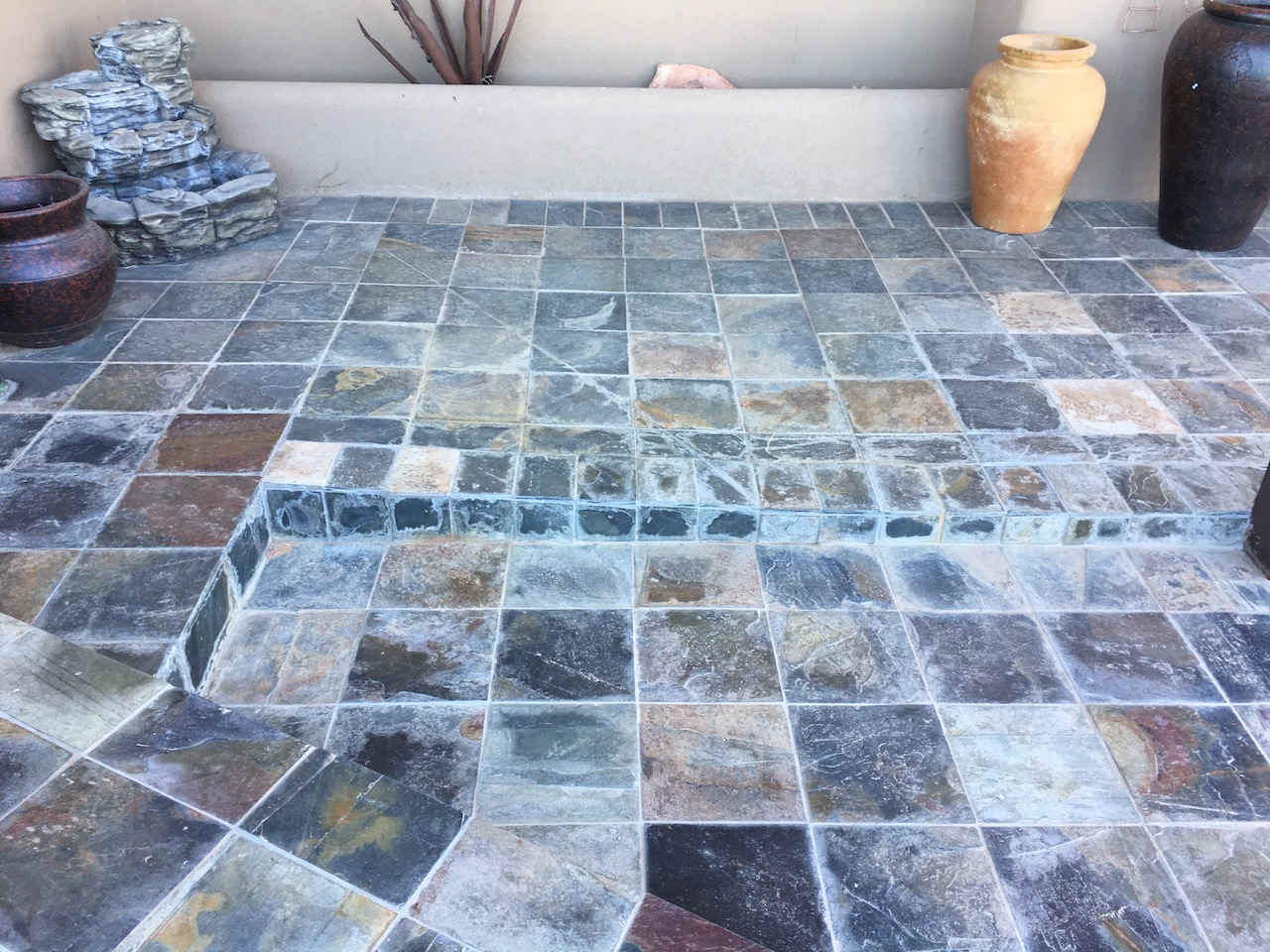 Before picture of multi-colored slate patio